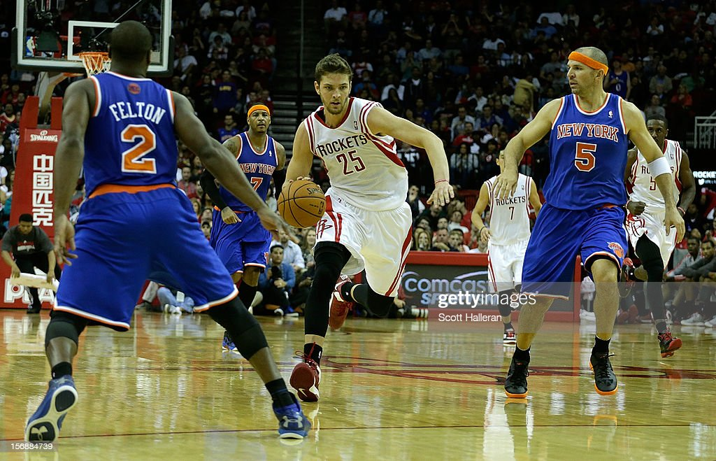 Chandler Parsons #25 of the Houston Rockets drives upcourt against Jason Kidd #5 and Raymond Felton #2 of the New York Knicks at the Toyota Center on November 23, 2012 in Houston, Texas.