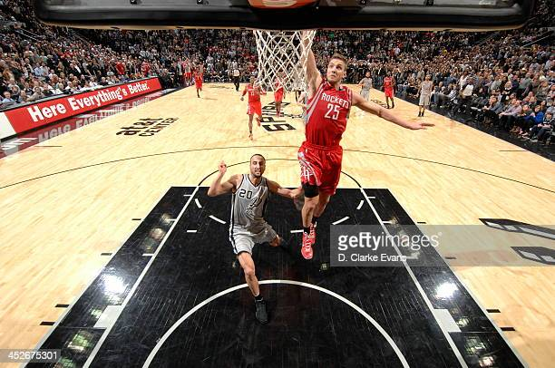 Chandler Parsons of the Houston Rockets dunks against the San Antonio Spurs at the ATT Center on November 30 2013 in San Antonio Texas NOTE TO USER...