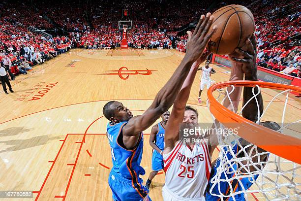 Chandler Parsons of the Houston Rockets dunks the ball against Kendrick Perkins and Serge Ibaka of the Oklahoma City Thunder in Game Four of the...