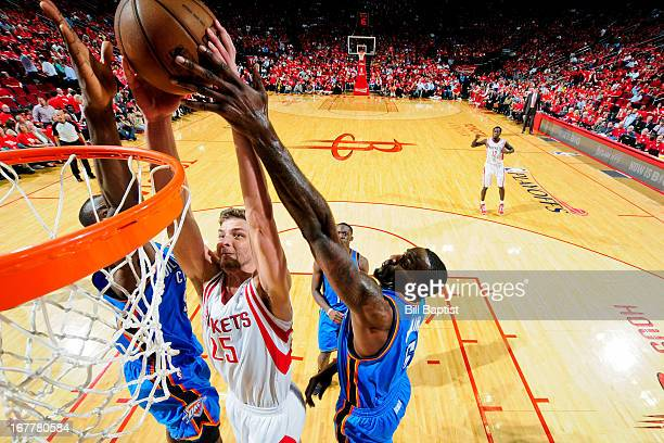 Chandler Parsons of the Houston Rockets dunks the ball against Serge Ibaka and Kendrick Perkins of the Oklahoma City Thunder in Game Four of the...