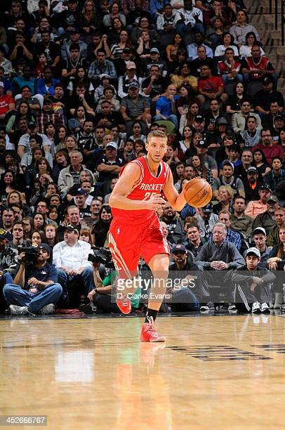 Chandler Parsons of the Houston Rockets moves the ball upcourt San Antonio Spurs at the ATT Center on November 30 2013 in San Antonio Texas NOTE TO...