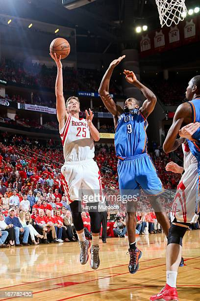 Chandler Parsons of the Houston Rockets shoots a layup against Serge Ibaka of the Oklahoma City Thunder in Game Four of the Western Conference...