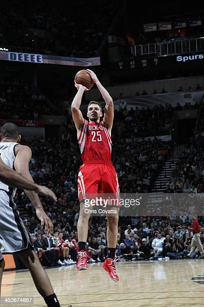 Chandler Parsons of the Houston Rockets shoots against the San Antonio Spurs on November 30 2013 at the ATT Center in San Antonio Texas NOTE TO USER...