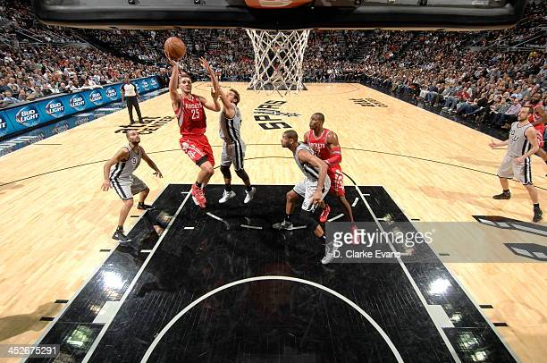 Chandler Parsons of the Houston Rockets shoots against the San Antonio Spurs at the ATT Center on November 30 2013 in San Antonio Texas NOTE TO USER...