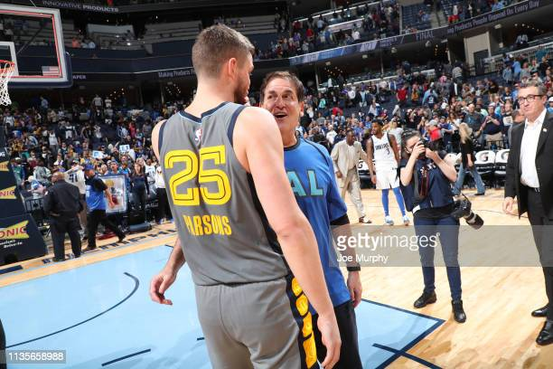 Chandler Parsons of the Memphis Grizzlies and Owner of the Dallas Mavericks Mark Cuban talk after a game on April 7 2019 at FedExForum in Memphis...