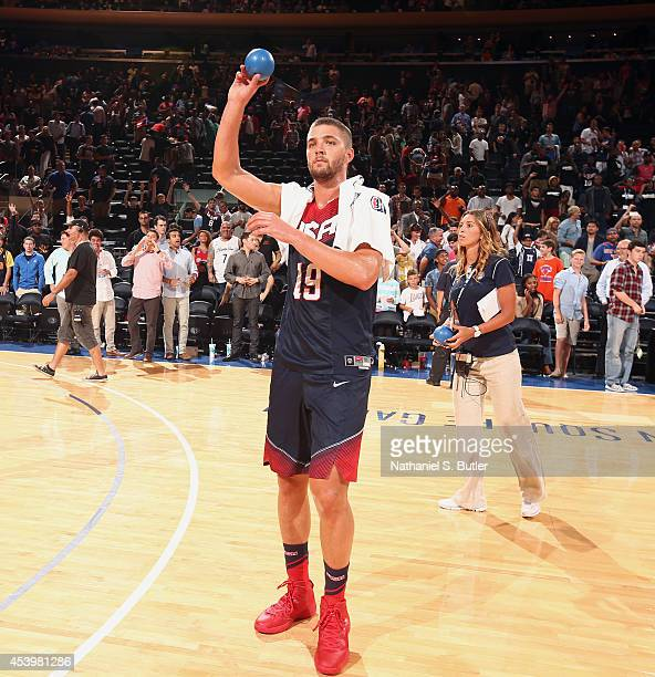 Chandler Parsons of the USA Basketball Men's National Team throws a signed ball into the crowd following a game against the Puerto Rico Basketball...