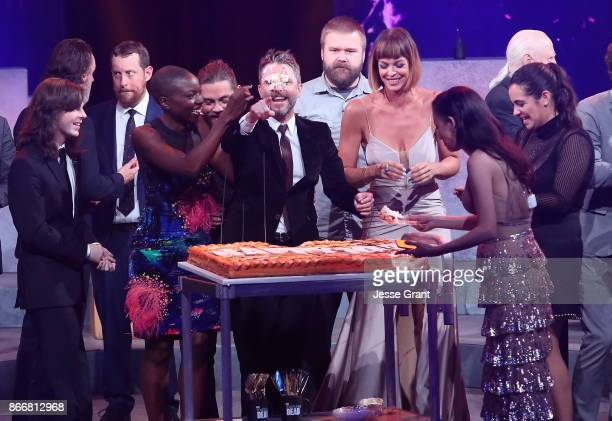 Chandler Riggs Danai Gurira host Chris Hardwick Pollyanna McIntosh Christian Serratos and Alanna Masterson attend The Walking Dead 100th Episode...