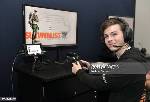 Chandler Riggs playing Tom Clancy's The Division 2 during E3 2018 at Los Angeles Convention Center on June 13 2018 in Los Angeles California