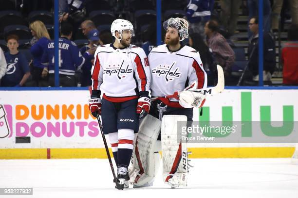 Chandler Stephenson and Braden Holtby of the Washington Capitals celebrate after defeating the Tampa Bay Lightning in Game Two of the Eastern...