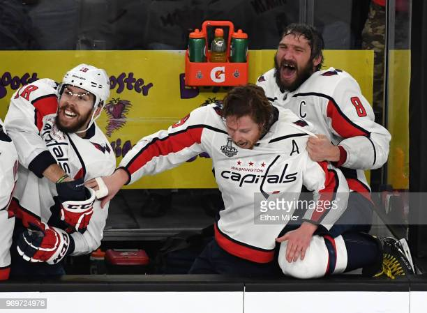 Chandler Stephenson Nicklas Backstrom and Alex Ovechkin of the Washington Capitals celebrate their 43 win over the Vegas Golden Knights as time...