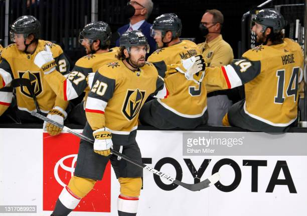 Chandler Stephenson of the Vegas Golden Knights celebrates with teammates on the bench after scoring a first-period short-handed goal against the St....