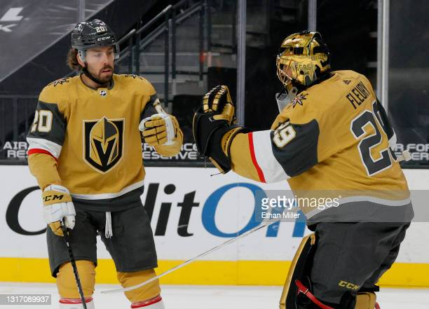 Chandler Stephenson of the Vegas Golden Knights celebrates with Marc-Andre Fleury after Stephenson scored a first-period short-handed goal against...