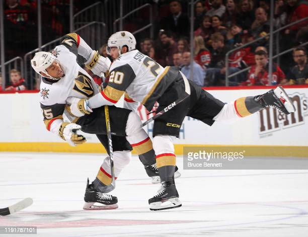 Chandler Stephenson of the Vegas Golden Knights collides with Ryan Reaves during the third period against the New Jersey Devils at the Prudential...