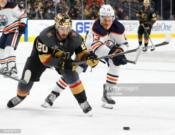 Chandler Stephenson of the Vegas Golden Knights controls the puck against Jesse Puljujarvi of the Edmonton Oilers in the second period of their game...
