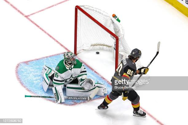 Chandler Stephenson of the Vegas Golden Knights scores a goal past Anton Khudobin of the Dallas Stars during the first period in Game Five of the...
