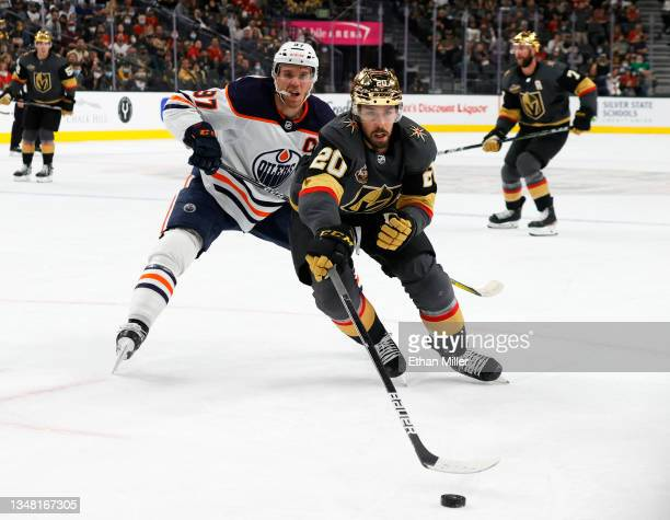 Chandler Stephenson of the Vegas Golden Knights skates with the puck against Connor McDavid of the Edmonton Oilers in the second period of their game...