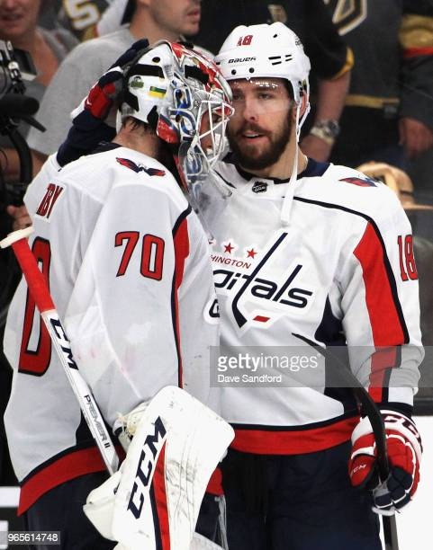 Chandler Stephenson of the Washington Capitals congratulates goaltender Braden Holtby after their team defeated the Vegas Golden Knights 32 in Game...