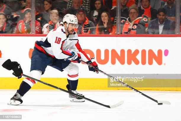 Chandler Stephenson of the Washington Capitals controls the puck against the Philadelphia Flyers in the second period at Wells Fargo Center on...