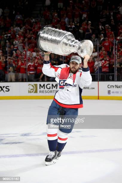 Chandler Stephenson of the Washington Capitals hoists the Stanley Cup after his team defeated the Vegas Golden Knights 43 in Game Five of the 2018...