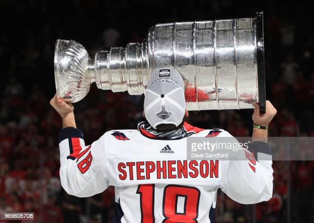 Chandler Stephenson of the Washington Capitals hoists the Stanley Cup after Game Five of the 2018 NHL Stanley Cup Final between the Washington...