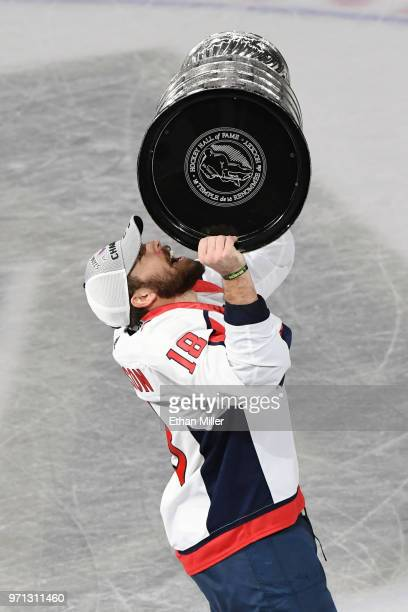 Chandler Stephenson of the Washington Capitals hoists the Stanley Cup after Game Five of the 2018 NHL Stanley Cup Final at TMobile Arena on June 7...