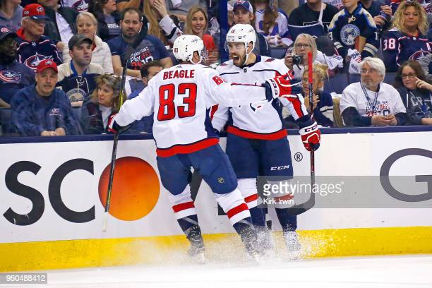 Chandler Stephenson of the Washington Capitals is congratulated by Jay Beagle of the Washington Capitals after scoring a goal during the third period...