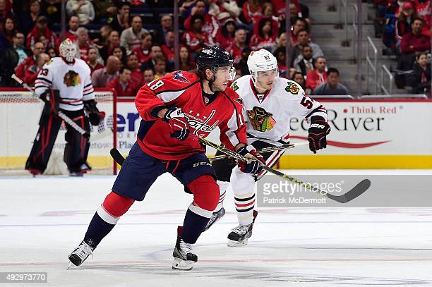 Chandler Stephenson of the Washington Capitals skates against the Chicago Blackhawks in the second period during an NHL game at Verizon Center on...