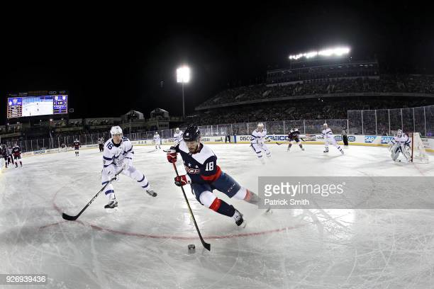 Chandler Stephenson of the Washington Capitals skates past Mitchell Marner of the Toronto Maple Leafs during the second period in the Coors Light NHL...