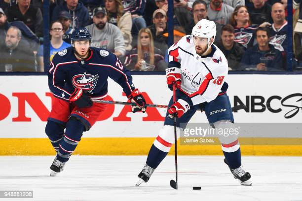 Chandler Stephenson of the Washington Capitals skates the puck away from Ryan Murray of the Columbus Blue Jackets during the third period in Game...