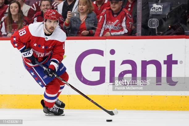 Chandler Stephenson of the Washington Capitals skates with the puck in the third period against the New York Islanders at Capital One Arena on April...