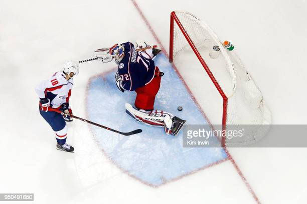 Chandler Stephenson of the Washington Capitals slides the puck past Sergei Bobrovsky of the Columbus Blue Jackets for a goal during the third period...