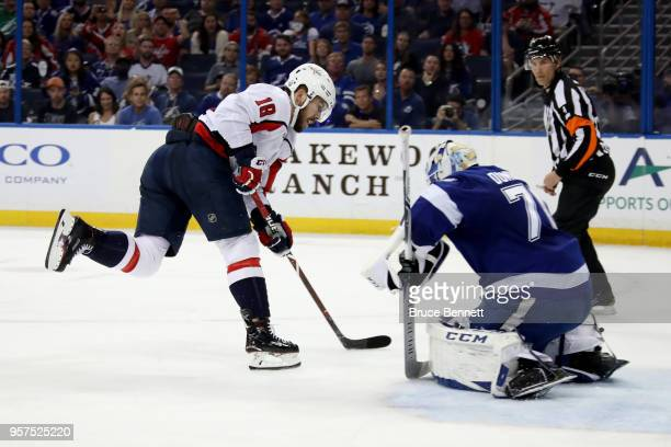Chandler Stephenson of the Washington Capitals takes a shot on Louis Domingue of the Tampa Bay Lightning during the third period in Game One of the...