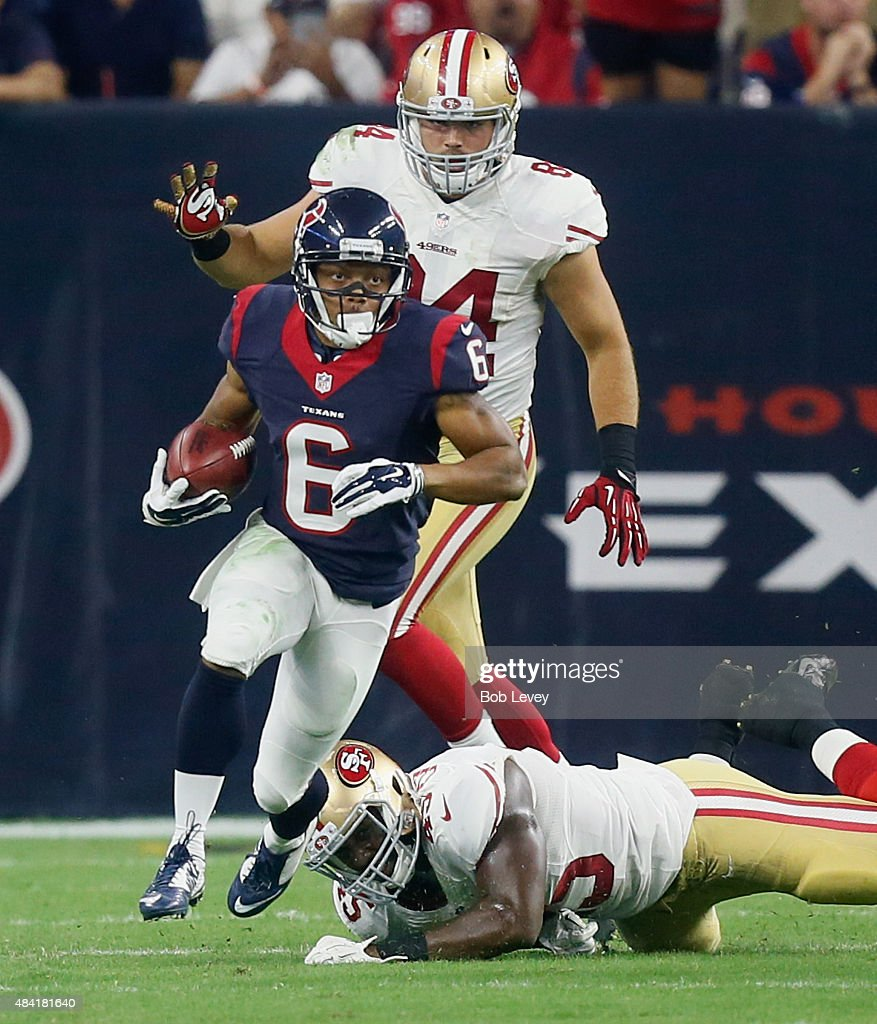 Chandler Worthy #6 of the Houston Texans breaks a tackle attempt by Asante Cleveland #45 of the San Francisco 49ers at Reliant Arena at Reliant Park on August 15, 2015 in Houston, Texas.