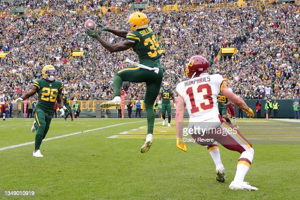 Chandon Sullivan of the Green Bay Packers intercepts a pass intended for Adam Humphries of the Washington Football Team during a game at Lambeau...