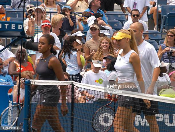 Chandra Rubin, Anna Kournikova and Andre Agassi during 2003 US Open - Arthur Ashe Kids Day at USTA National Tennis Center in Queens, New York, United...