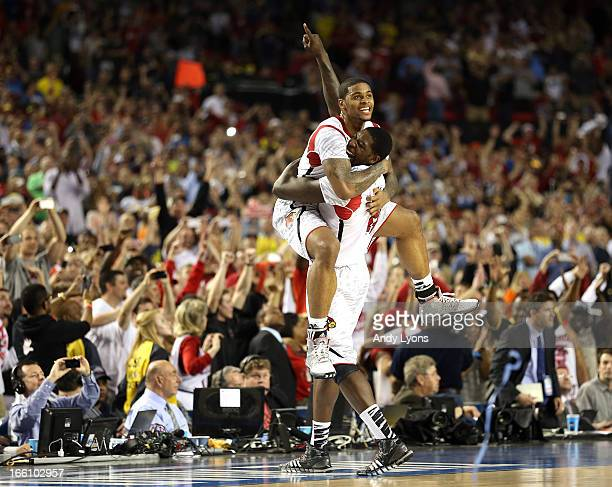 Chane Behanan and Montrezl Harrell of the Louisville Cardinals celebrate after they won 82-76 against the Michigan Wolverines during the 2013 NCAA...