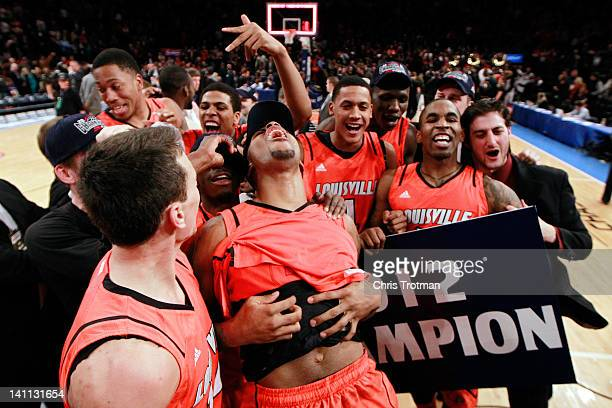 Chane Behanan and the Louisville Cardinals celebrate after defeating the Cincinnati Bearcats during the finals of the Big East Men's Basketball...