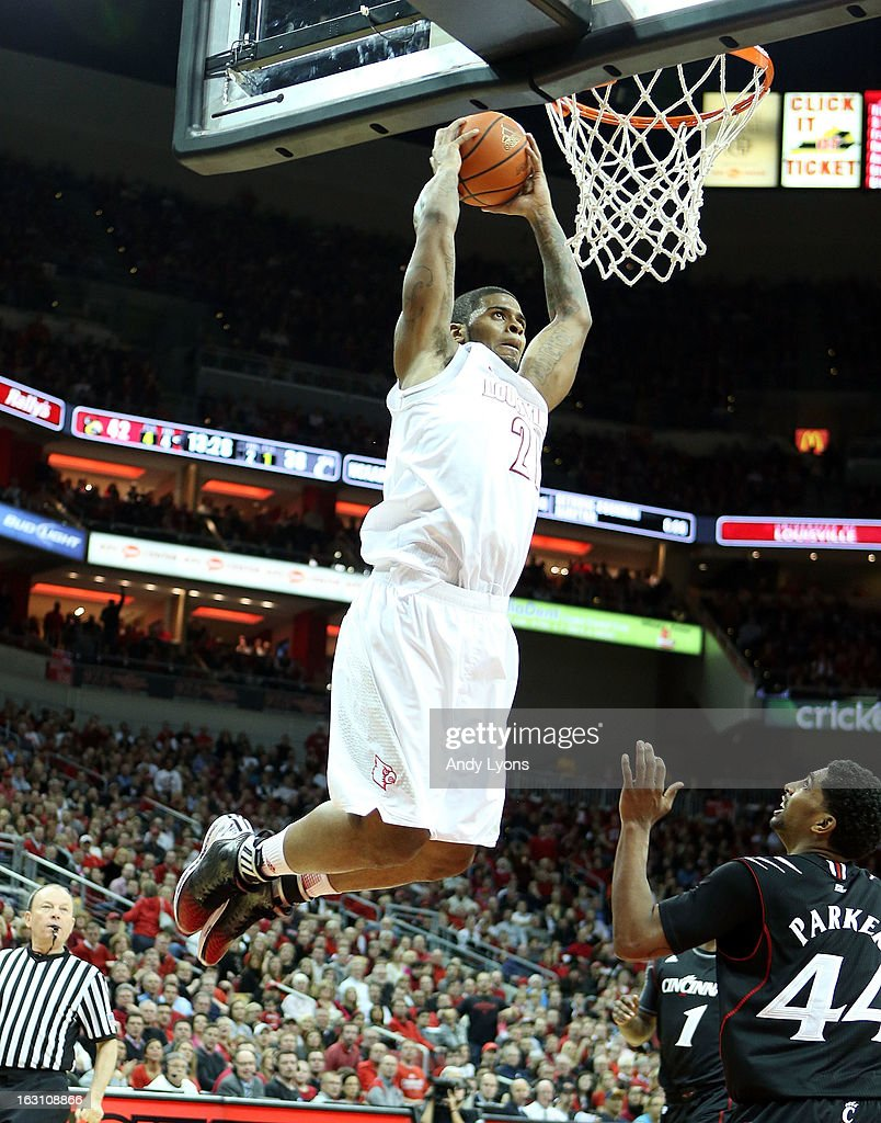 Chane Behanan #21 of the Louisville Cardinals dunks the ball during the game against the Cincinnati Bearcats at KFC YUM! Center on March 4, 2013 in Louisville, Kentucky.