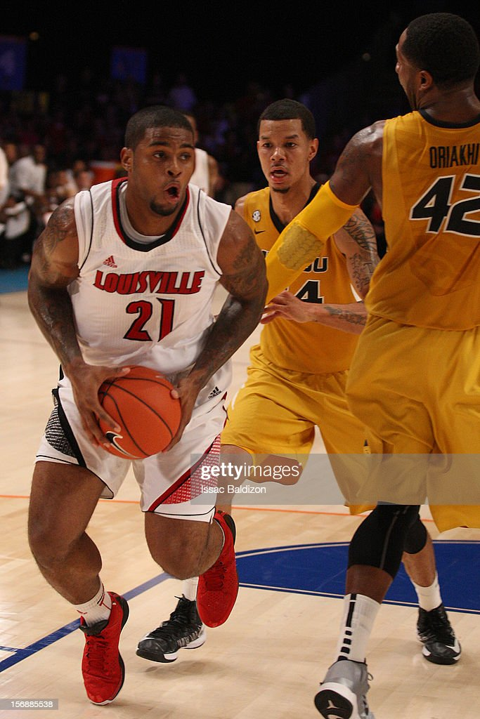 Chane Behanan #21 of the Louisville Cardinals gathers a rebound during the Battle 4 Atlantis tournament at Atlantis Resort November 23, 2012 in Nassau, Paradise Island, Bahamas.