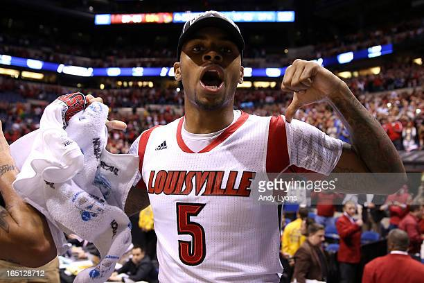 Chane Behanan of the Louisville Cardinals wearing the jersey belonging to teammate Kevin Ware celebrates after they won 8563 against the Duke Blue...