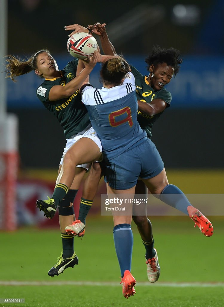 Chane Stadler (L) and Phumeza Gadu (R) of South Africa jump to the ball during the match between France and South Africa on Day One of the Emirates Dubai Rugby Sevens - HSBC Sevens World Series at The Sevens Stadium on November 30, 2017 in Dubai, United Arab Emirates.