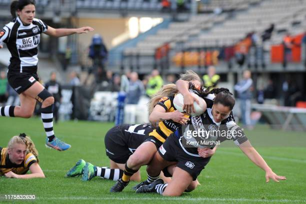 Chanel Atkin of Hawke's Bay scores a try during the round 4 Farah Palmer Cup match between Hawke's Bay and Taranaki at McLean Park on September 20...