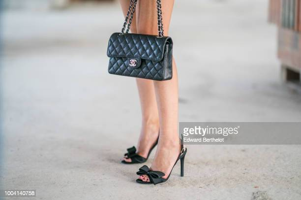 Chanel bag and Charles Jourdan black heels shoes are seen during Feeric Fashion Week 2018 on July 22 2018 in Sibiu Romania