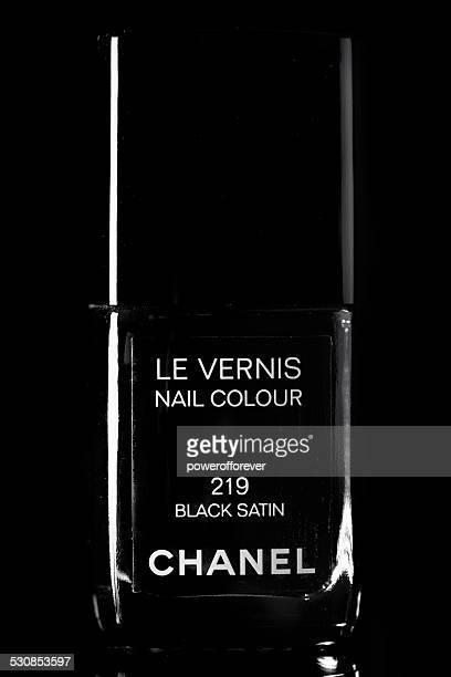 chanel black satin le vernis nail polish - black nail polish stock photos and pictures