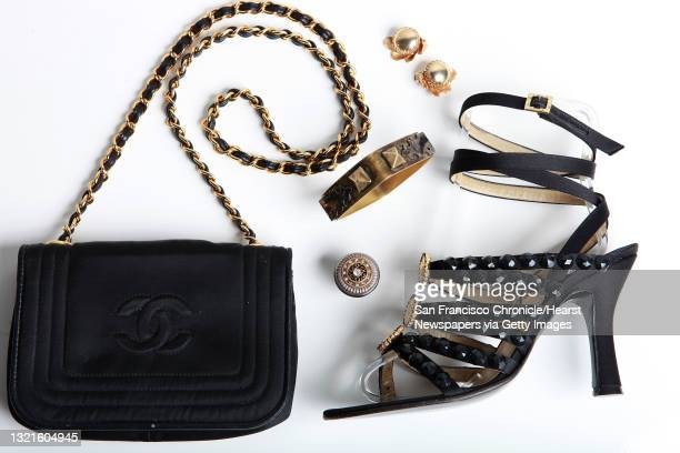 Chanel chain strapped purse, vintage gold clips, costume ring and bangle, and Gianni Versace sandals at Labels, a consignment store in Berkeley,...