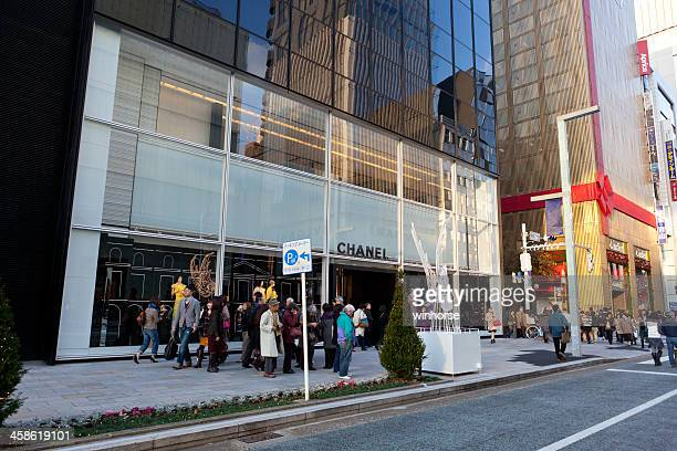 chanel flagship store in japan - chuo dori street stock photos and pictures
