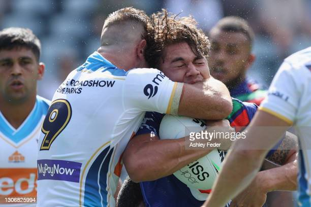 Chanel Harris-Tavita of the Warriors is tackled during the round one NRL match between the New Zealand Warriors and the Gold Coast Titans at Central...