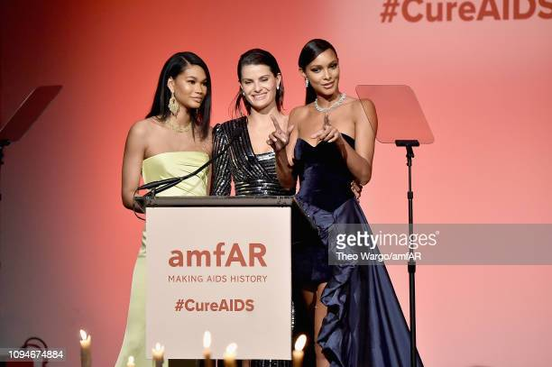 Chanel Iman Candice Swanepoel and Lais Ribeiro speak onstage during the amfAR New York Gala 2019 at Cipriani Wall Street on February 6 2019 in New...