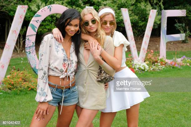 Chanel Iman Elsa Hosk and Josephine Skriver celebrate #REVOLVEintheHamptons Close Out Party with Moet Chandon on July 22 2017 in Bridgehampton New...