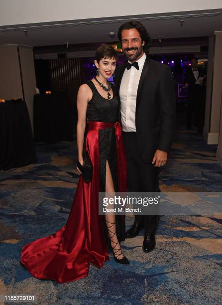 Chanel Joan Elkayam and Christian Vit attend The Caudwell Children Butterfly Ball at The Grosvenor House Hotel on June 13 2019 in London England